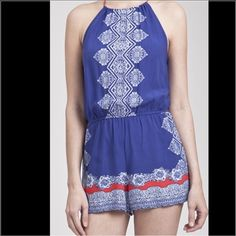 True Blue Romper Back tie sleeveless romper. Cute blue woven romper with white pattern & red detail.           🚫 trades.                                                                 Size Small fits 0,2.                                                    Size Medium fits 6.                                                  Size Large fits 10/12 Trindy Clozet Boutique Shorts