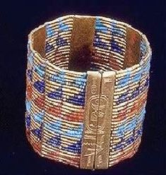 Gold with lapus lazuli and other precious beads; bracelet, Queen Ahhotep, name of King Ahmose I inscribed on the clasp; Dynasty XVIII; Egyptian Museum, Cairo.