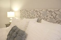 DIY: Upholstered Headboard. We just bought this crazy expensive bed frame and I really wish I had seen this first.