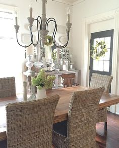 Farmhouse dining room with wicker chairs kellyelko.com