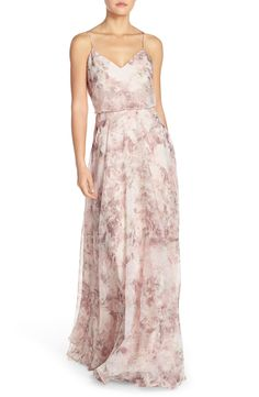 This muted floral print gown adds a romantic vibe to the wedding.