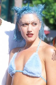 Gwen Stefani showcased blue hair styled in three mini top knots in the '90s