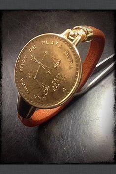 Moneda de Onza troy plata 1 ley chapada en oro y trasformada a pulsera cuero en nuestro taller