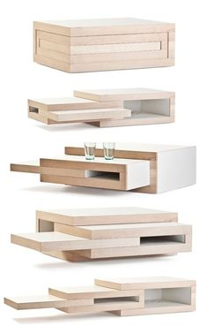 REK expandable coffee table - this is cool and would be a major space saver in my living room!!!! yet lots of table when needed!! I want one!!!
