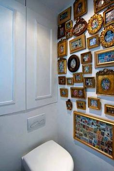 In this tiny powder room, hundreds of colorful stamps are framed in gilt vintage frames. In this space, more is more!