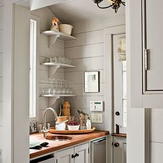 An Atlanta couple bring a little New England charm when they renovated their 1930s Cape Cod-style cottage. Check out these charming home tou...
