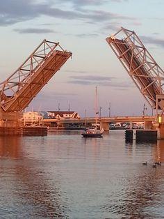 Sturgeon Bay's Michigan Street Bridge opens for a passing sailboat. Door County Wisconsin, Sturgeon Bay, Over The Bridge, Lake Michigan, Rental Property, Lighthouses, Sailboat, Golden Gate Bridge, Bridges