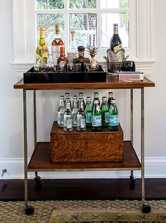 No office bar is complete without bottles of water—an easy grab during any meeting. Alex completed the look with malachite matchboxes and a brass pineapple. Bar Cart Styling, Bar Cart Decor, Caves, Bar Cart Essentials, Le Catch, Office Bar, Office Chic, Office Decor, Office Makeover