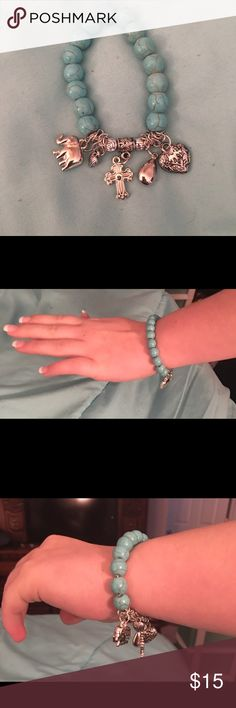 """JUST ARRIVED - fun turquoise charm bracelets Bundle for even more savings!! Very cute turquoise charm bracelet with elephant, heart and cross charms. Stretchable to fit most wrists    SIZE - 1.5""""H Jewelry Bracelets"""