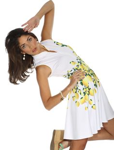 Our trailing lemons dress is the cover shot for our summer 2015 catalogue.  Featuring Golf Channel's Bailey Mosier #golffashion #golfdress #fashion #athleisure