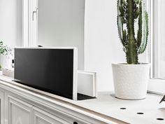 hidden tvs flat screen on a pop up lift concealed in a living room cabinet ofu2026