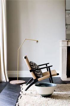 Love the lines on this chair and the contrast between the tan and the black. There is also like the contrast between the flooring and the carpet. Doesn't that carpet look soft!? Wonderful piece of pottery as well.
