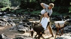 """British Colonial Campaign Furniture: ...and the sexiest scene in movie history. Meryl Streep (as Karen Blixen) & Robert Redford (as Denys Finch Hatton) in """"Out of Africa"""". The couple are outfitted for a 1917-era hunting trip with canvas wash basin/stand & folding campaign chair."""