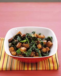 Curried sweet potatoes and spinach make a dish that is hearty enough to be a meal.