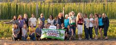 Knowledgeable women sharing craft beer with women - Farm to Bottle Feast 2012 at Rogue Hop Farm