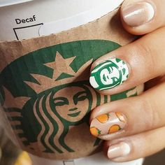 Show love for your favorite fall drink with this #PSL inspired nail art.  Image from Instagram user ayewuykenails