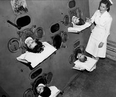 Children in iron lungs - 1950's?  Thank goodness we no longer use these things.