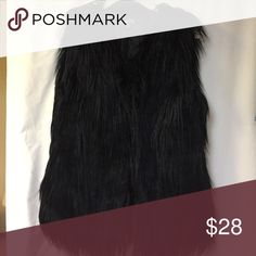 """NEW Shaggy Faux Fur Vest ** MY PHONE RAN OUT OF STORAGE, SO WILL POST MORE PICS SOON. 😕                         New without tags. Black faux fur vest. Side pockets, 6 hook and eye front closures. Satin lined. Measures 27"""" in length. True to size. V neck, no collar.                                                                             Thank you for looking, and ..... happy Poshing!! 🛍 Rue 21 Jackets & Coats Vests"""