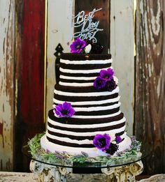 The contrast between a dark chocolate wedding cake and stark white icing is stunning to say the least. Finish the look with some strategically placed vibrant blooms and simple garland around the base for a totally elegant look.