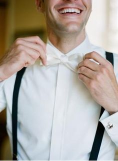 grooms but with a black tie