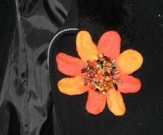 Felted flower brooch by JuliePavittRobinson on Etsy