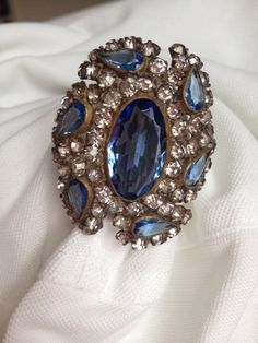 Lovely large antique hatpin with beautifully cut blue glass stones with clear rhinestone accents.  Circa 1910.