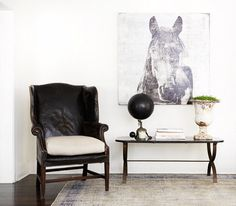 Vintage furniture with faded horse art