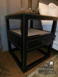 Black lacquer accent table with rattan accents. Measures 22x22x25. Two in store at time of posting as well as a matching chest.