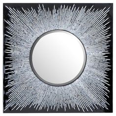 Beveled wall mirror with a reflective sunburst frame on a black background.   Product: MirrorConstruction Material: ...