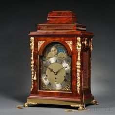 "Charles Cabrier Musical Table Clock, London, c. 1780, the mahogany case with pagoda top, pierced side frets backed with fabric, carrying handles, scrolled feet and brass mounts flanking the tombstone-shaped glazed door over the composite brass dial with silvered Roman numeral chapter ring, subsidiary dials, one for ""Strike-Silent"" and signed Charles Cabrier, London,"
