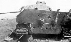 """Battle of Kursk, July 1943: A knocked out Panther tank lies in the battlefield of the biggest ever clash of armored forces. The wreck has been most likely signed by the Russian who knocked it out: """"Illin, 27/7""""."""