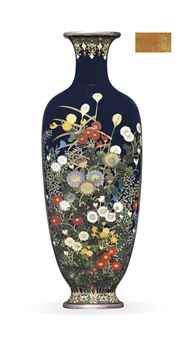 A Cloisonné Vase Signed Dai Nihon Hayashi Kodenji sei, Meiji Period (late 19th century) The slender vase worked in various thicknesses of silver wire and coloured cloisonné enamels with a profusion of chrysanthemums and other flowers against a dark blue ground, the everted neck and foot with stylised floral motifs, silver rims