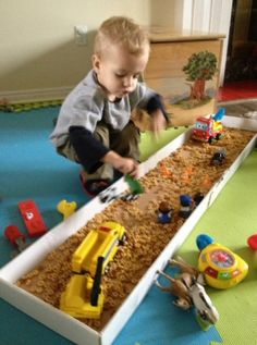 Fun Sensory Bin Box. Love that they used cereal instead of messy sand!