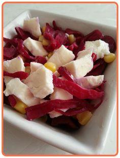 Salad with mozzarella, corns and red cabbage in vinegar.