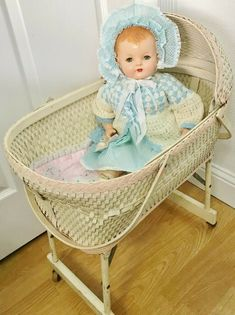 This ADORABLE bassinet has pale pink accent, this folds as shown in photos. From floor to bed edge, approx from floor to moveable hood top, Length (inside) and Wide inside. Baby Doll Bed, Baby Dolls, Mountain Nursery, Baby Bassinet, Dream Baby, White Wicker, Happy Baby, Doll Furniture, Vintage Yellow