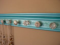 This wall hung rack with its attractive finish and embossed background will add beauty and function to your storage and organizational needs  So Many possible uses. Towel / robe holder , Scarves,Jewelry, necklaces. purse and coat rack are just a few.      Perfect handmade gift.One size fits all .Choices designed to match your decor and style.  Special orders available on color combinations, overall length and number of knobs.  Just convo me with your specific needs or ideas    Wood base is…