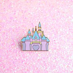 Home+is+where+the+heart+is+♡  This+castle+pin+is+a+sweet+reminder+of+where+dreams+do+come+true.+Take+a+little+piece+of+home+with+you,+so+you+can+always+feel+the+magic+wherever+you+are!!  This+pin+features+a+glitter+touch+in+the+rooftops+which+sparkles+in+the+sun!+This+pin+is++also+the+same+si...