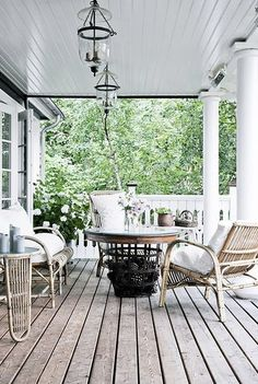 I want a porch like this.  Love the hurricanes and the raw wood.