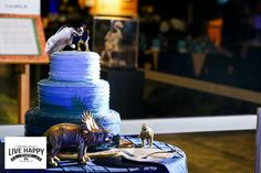 This beautiful dinosaur themed cake is the perfect addition to a Dino Digs wedding.  Photo By: Live Happy Studio