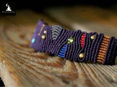 Purple unisex handmade Macrame Bracelet with abstract design, colorful details, brass and glass beads.  The thread used is high quality waxed