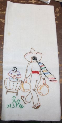 Linen towel, hand-embroidered with Mexican scene.