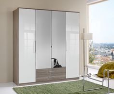 Add room to your home décor by purchasing this Gastinau #wardrobe having #mirrors on its front panel. It provides plenty of storage area with the help of 2 #drawers and 4 doors. It is polished in oak finish.