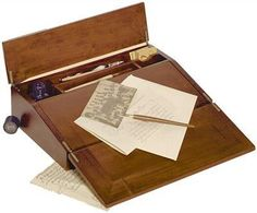 Elizabeth Bronte Lap Desk - This cleverly executed portable letter-writing surface will stash all stationery necessities within a handsomely hand rubbed cabinet with brass appointments