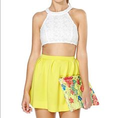 SCUBA SKATER SKIRT From Nasty Gal SCUBA SKATER SKIRT From NASTY GAL.                 Color: Yellow.                                                                The ultimate neon yellow neoprene skirt featuring a high waist and pleated detailing. Exposed zip closure at back, unlined. *Polyester/Spandex Blend  *Runs true to size Nasty Gal Skirts