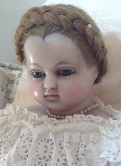 A gentle demeanour and a very interesting widow's peak creating a heart-shaped hairline make this doll a unique little person!