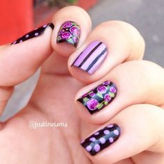 Pretty floral and cute spots and stripes in this cohesive but mismatched mani by @justineisms.