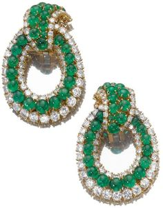 Pair of emerald and diamond ear clips, Van Cleef & Arpels. Of hoop design set with cabochon emeralds within graduated borders of brilliant-cut diamonds, mounted in gold, clip fittings, French assay and maker's marks. Sotheby's.