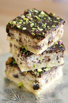 chocolate cannoli bars with dark chocolate ganache and pistachios
