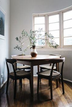Mid-century dining space in the beautiful 1920's home of photographer Nicolette Johnson, decorated on a shoe-string budget.
