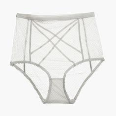 Sheer flocked polka dot mesh with slim velvet elastic panel detailing. Wide soft velvet elastic through waistline. Soft zig zag elastic through legline.